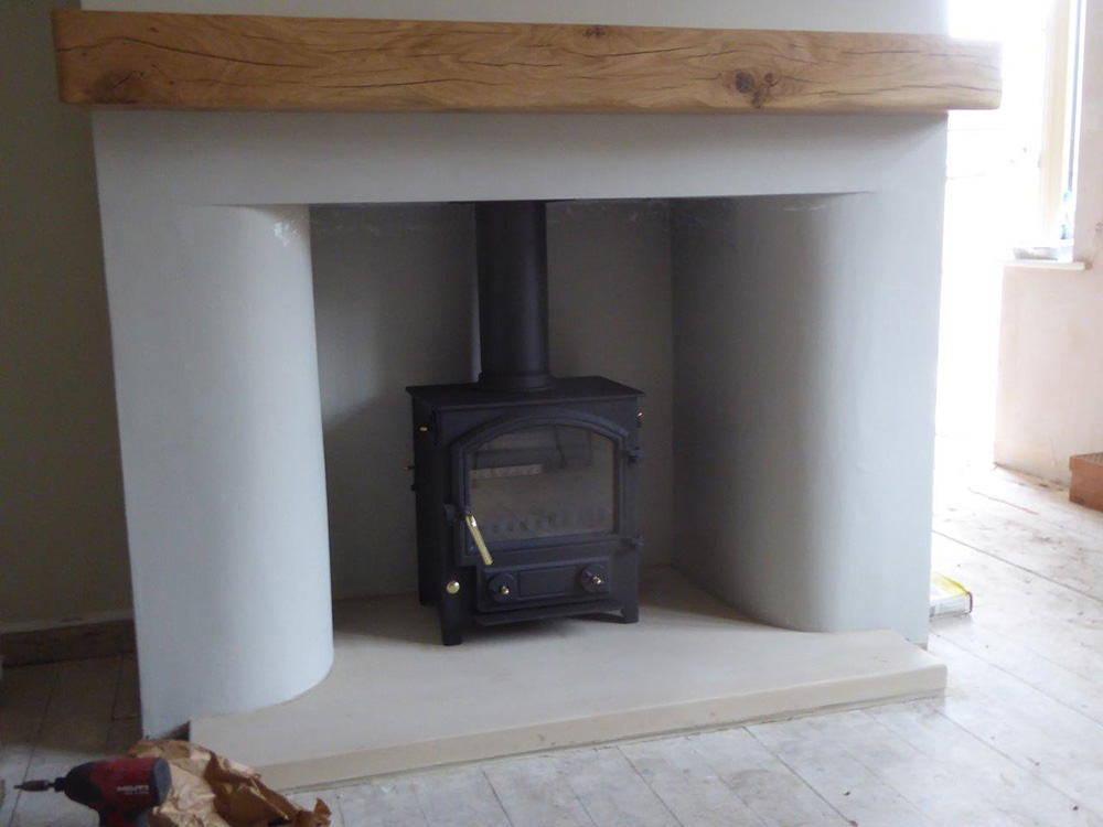 Town + Country Little Thurlow stove with solid oak beam fitted above.