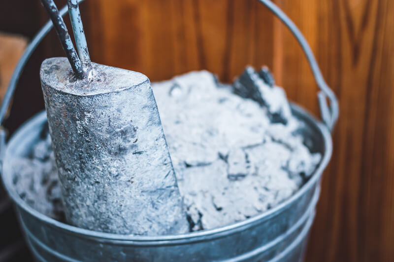 A close up image of a bucket of ash from a real fireplace,